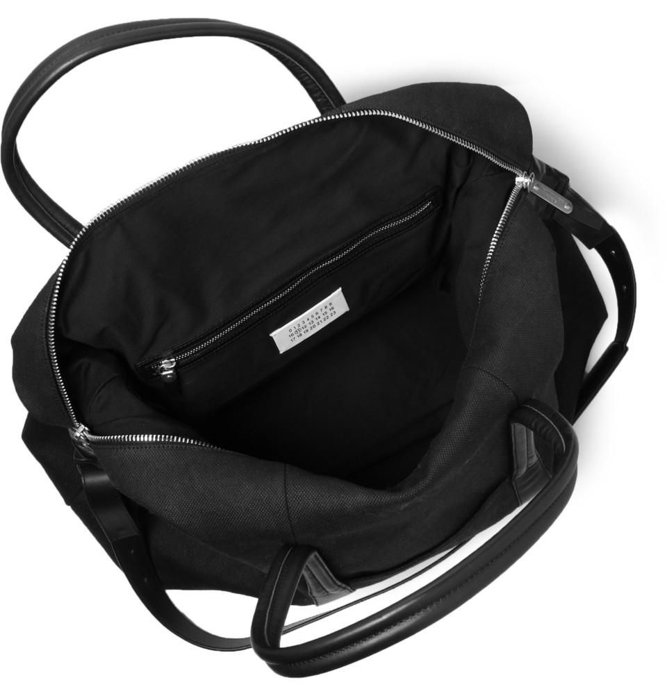 336461 mrp e1 xl Maison Martin Margiela Leather Trimmed Canvas Holdall Bag